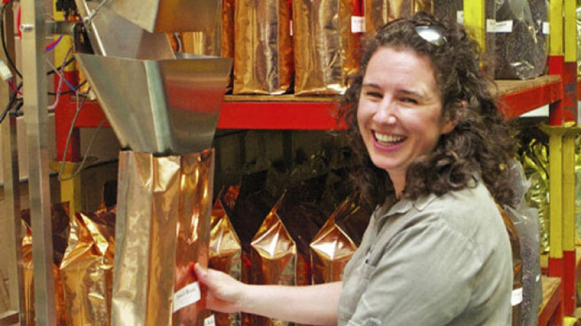 Bonnie Nowik-Cohen grinds coffee at Cape Cod Coffee Roasters