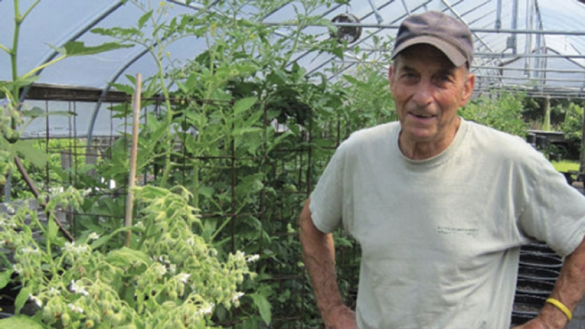 Jack Stacy stands in front of his organic garden