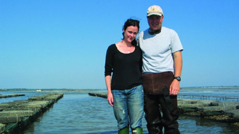 Jon Martin and wife Kate wade in water at Moon Shoal Oysters