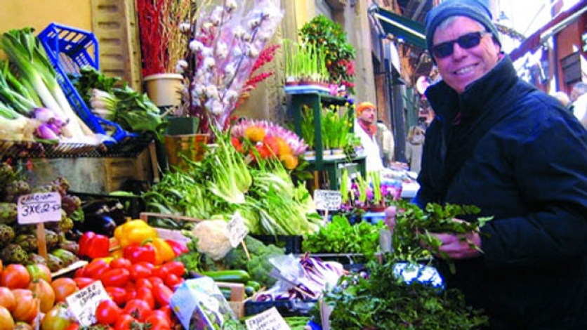 Man picks out fresh vegetables at the farmers market