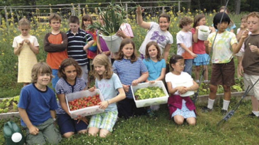 Kids at the Waldorf School in Cape Cod garden for school lunch