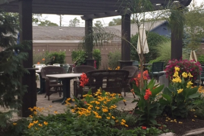 Cup 2 Cafe has a new outdoor dining patio with seating for 50, complete with teak dining furniture, pergula and lounge area