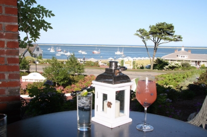 Enjoy a cocktail on the outside veranda of Chatham Bars Inn with a view of both the calm waters of Chatham Harbor and the rougher Atlantic Ocean.