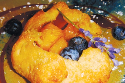 Blueberry, peach, and cream danish with homemade organic caramel sauce at Bluefish B&B.