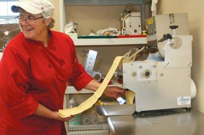 Kadlik and her pasta machine,