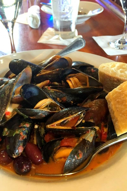 Steamed mussels with garlic, olives and capers in a spicy tomato sauce at Barnstable Restaurant and Tavern