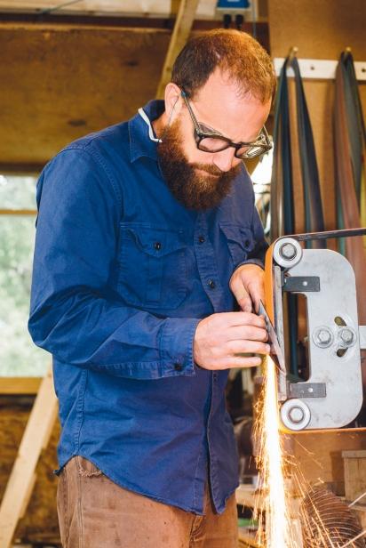 Densmore grinding a blade