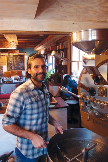 Snowy Owl owner Manuel Ainzuain roasts coffee beans.