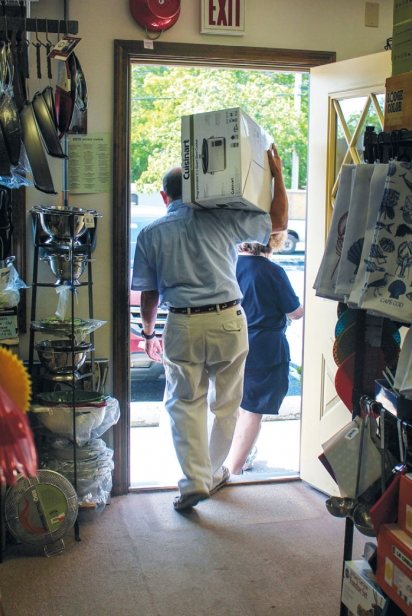 Customers leaving with appliance